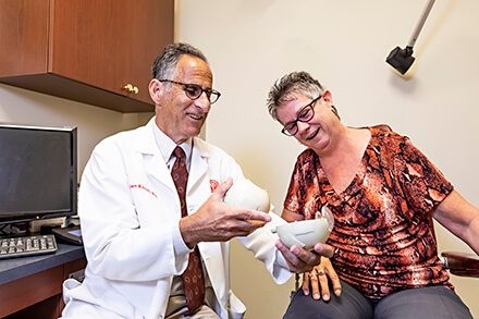 Dr. Kanoff Educating Patient With Eye Model